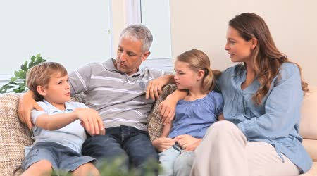 depositphotos_23694815-stock-video-happy-family-talking-together